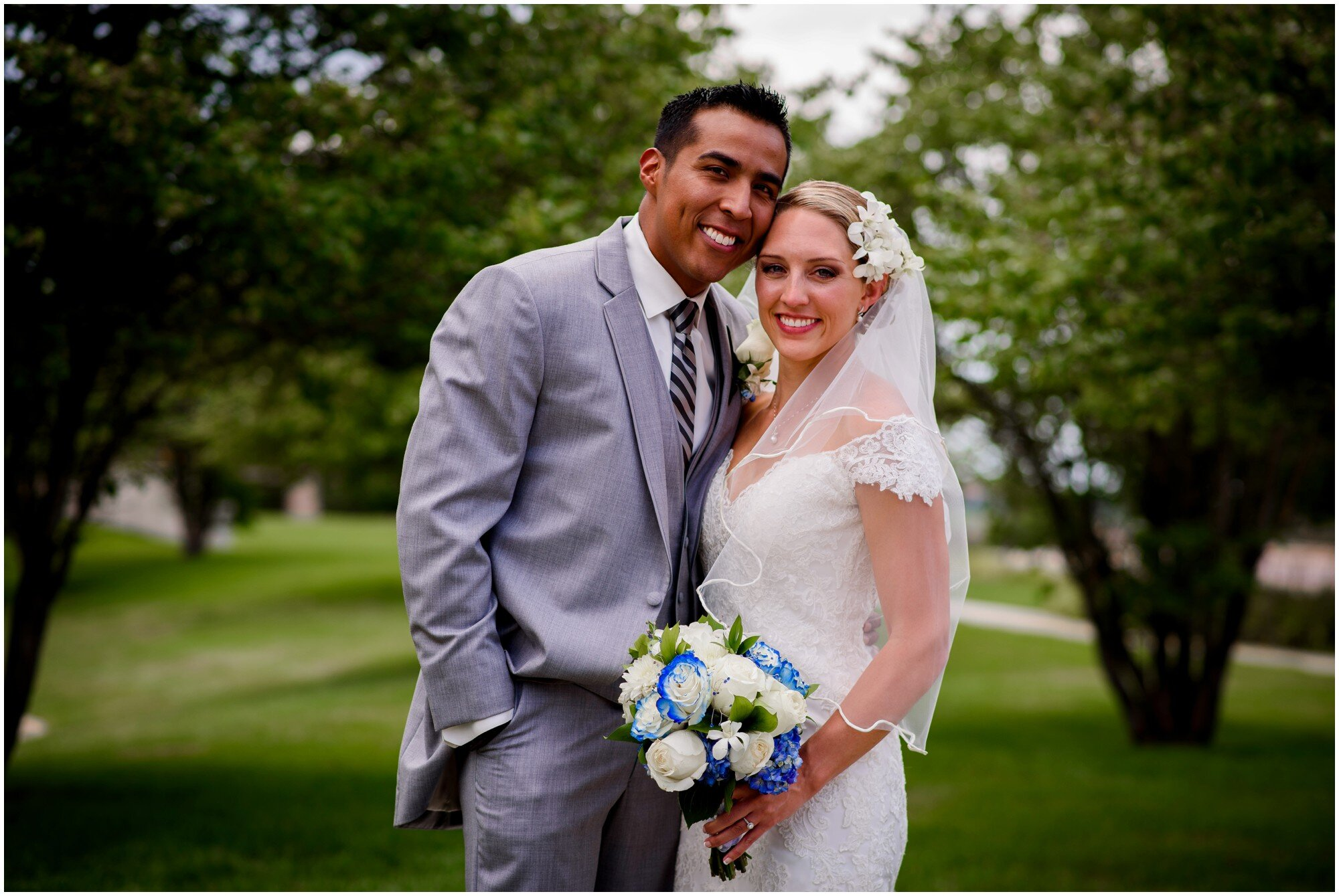 bride and groom with blue and white bouquet