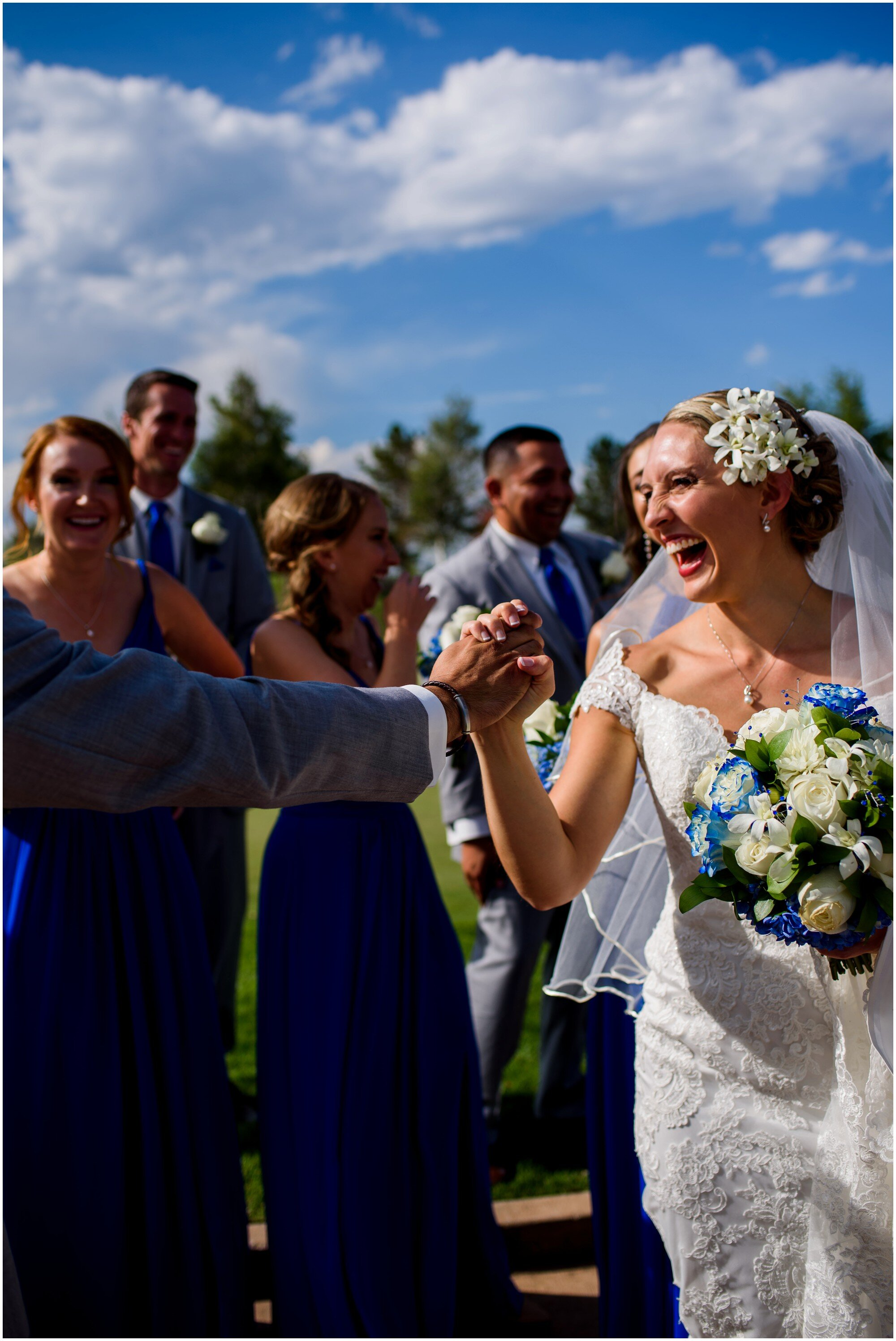 happy bride with blue and white bridal party