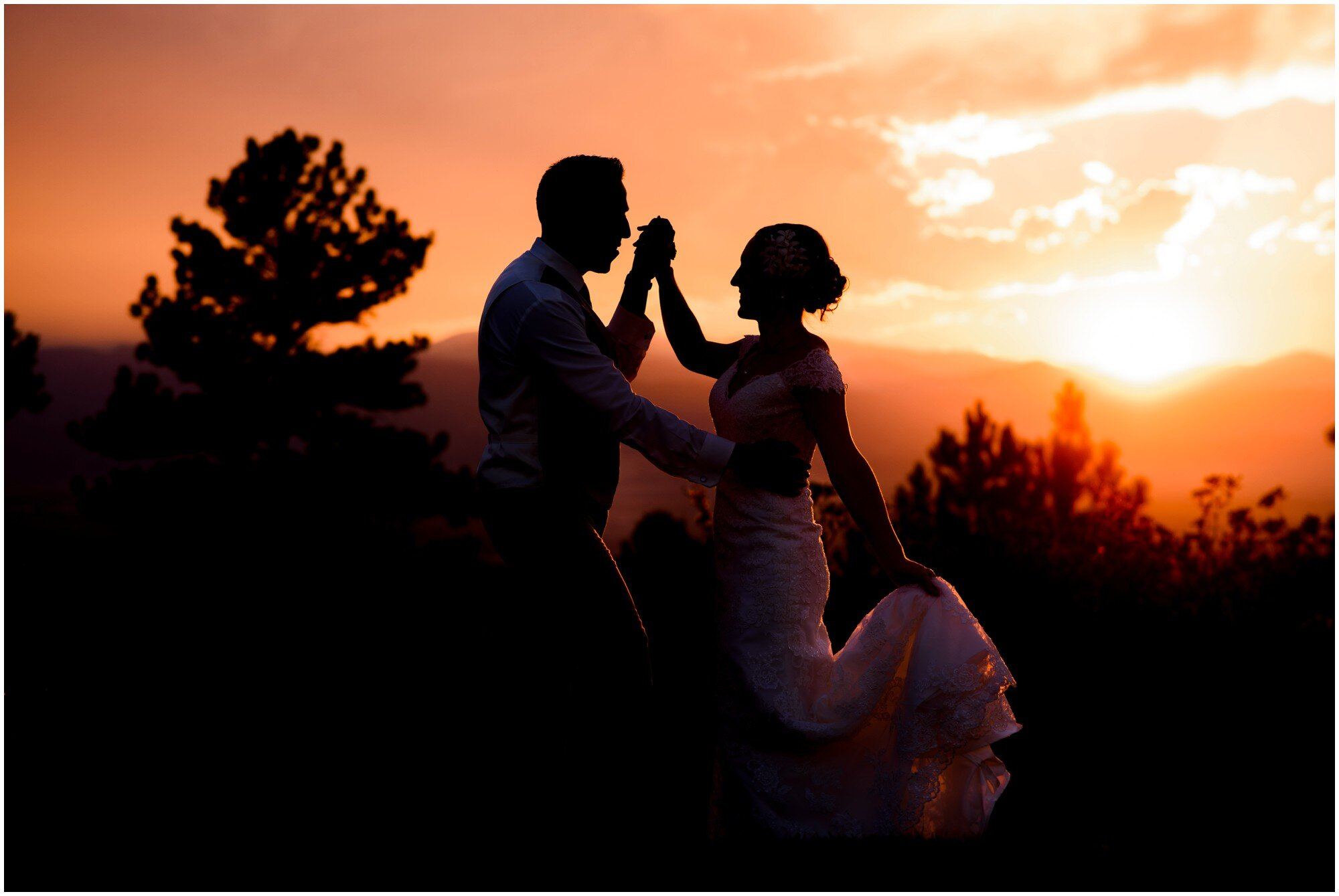 bride and groom dancing at sunset wedding