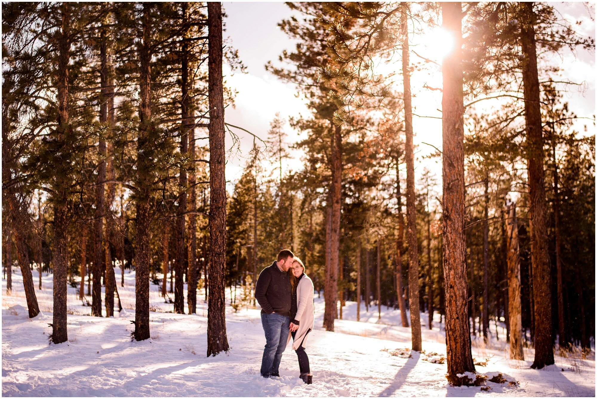 Sunny Winter engagement photo in Colorado mountains