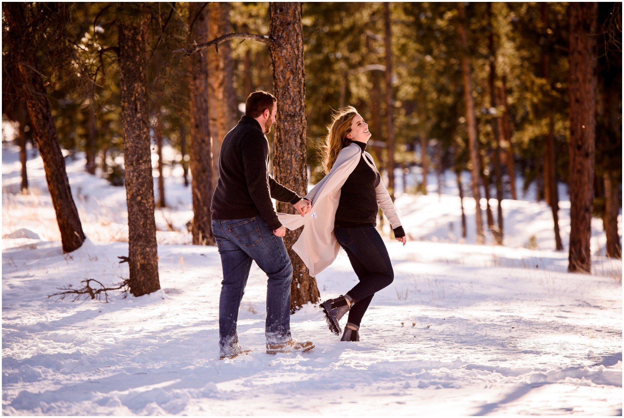 couple runs through snow in Colorado mountains