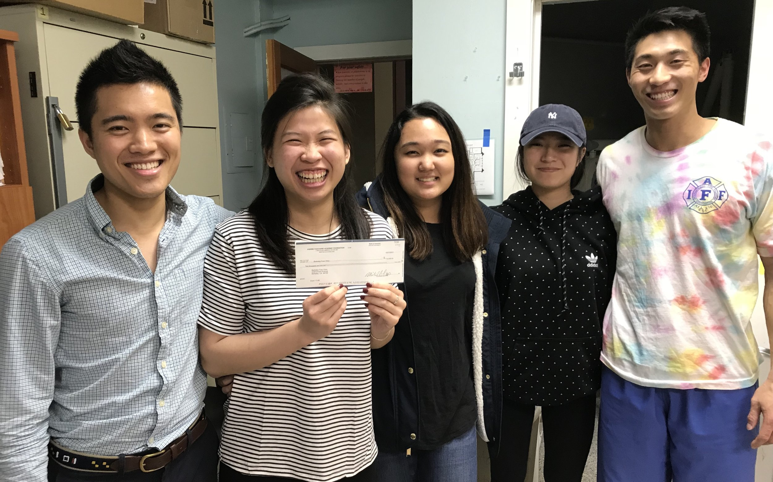 Dental Volunteers, Kevin, Michelle, Jessica, yoona, and rohen are all smiles with Oral Health Foundation donation