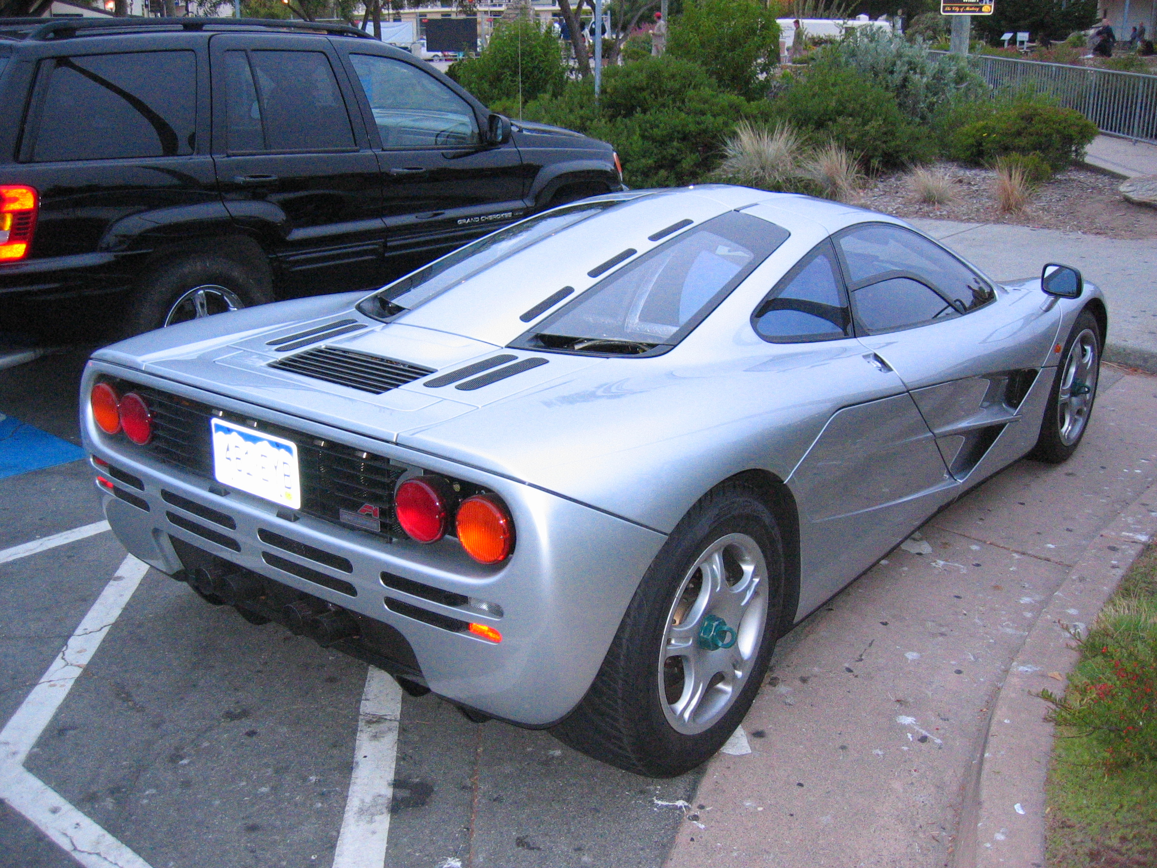 Yeah, that's a McLaren F1 double parked.  The title photo shows the parking ticket that was on the windscreen.