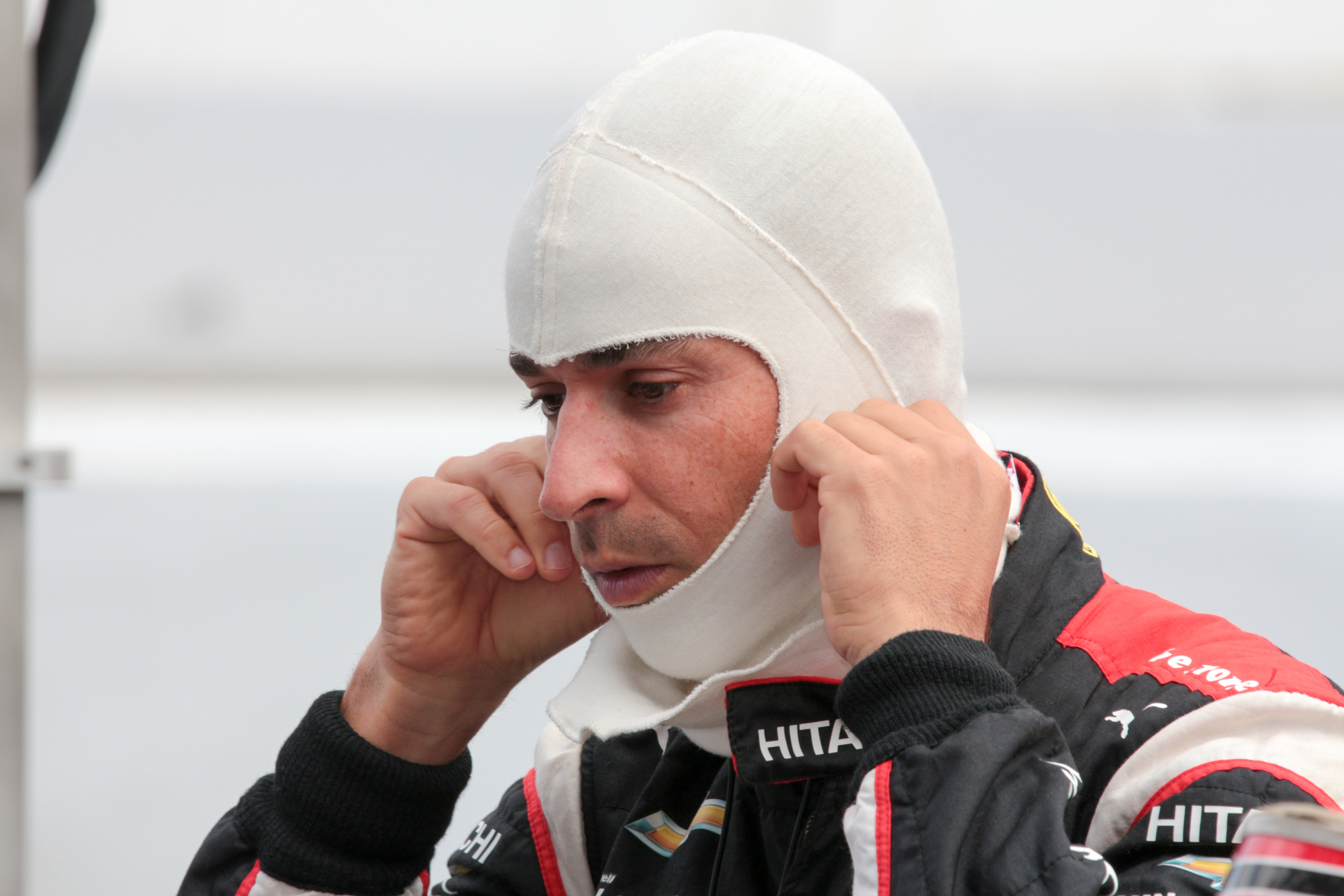 Team Penske Driver Helio Castroneves gets ready for qualifying.