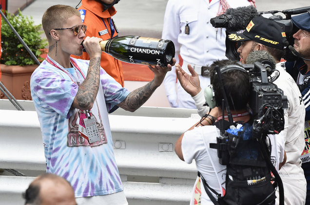 If you need any further reasons to dislike Hamilton here he is sharing his Monaco victory champagne with Bieber.