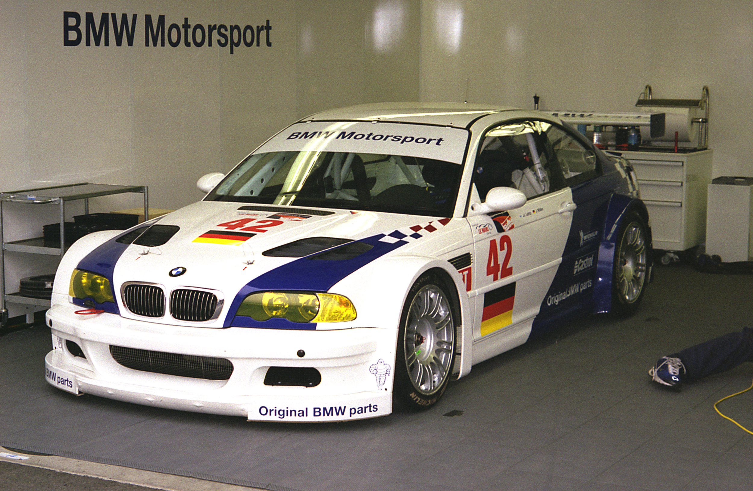 BMW M3 Schnitzer Factory Car in Garage with Leg and Shoe.jpg