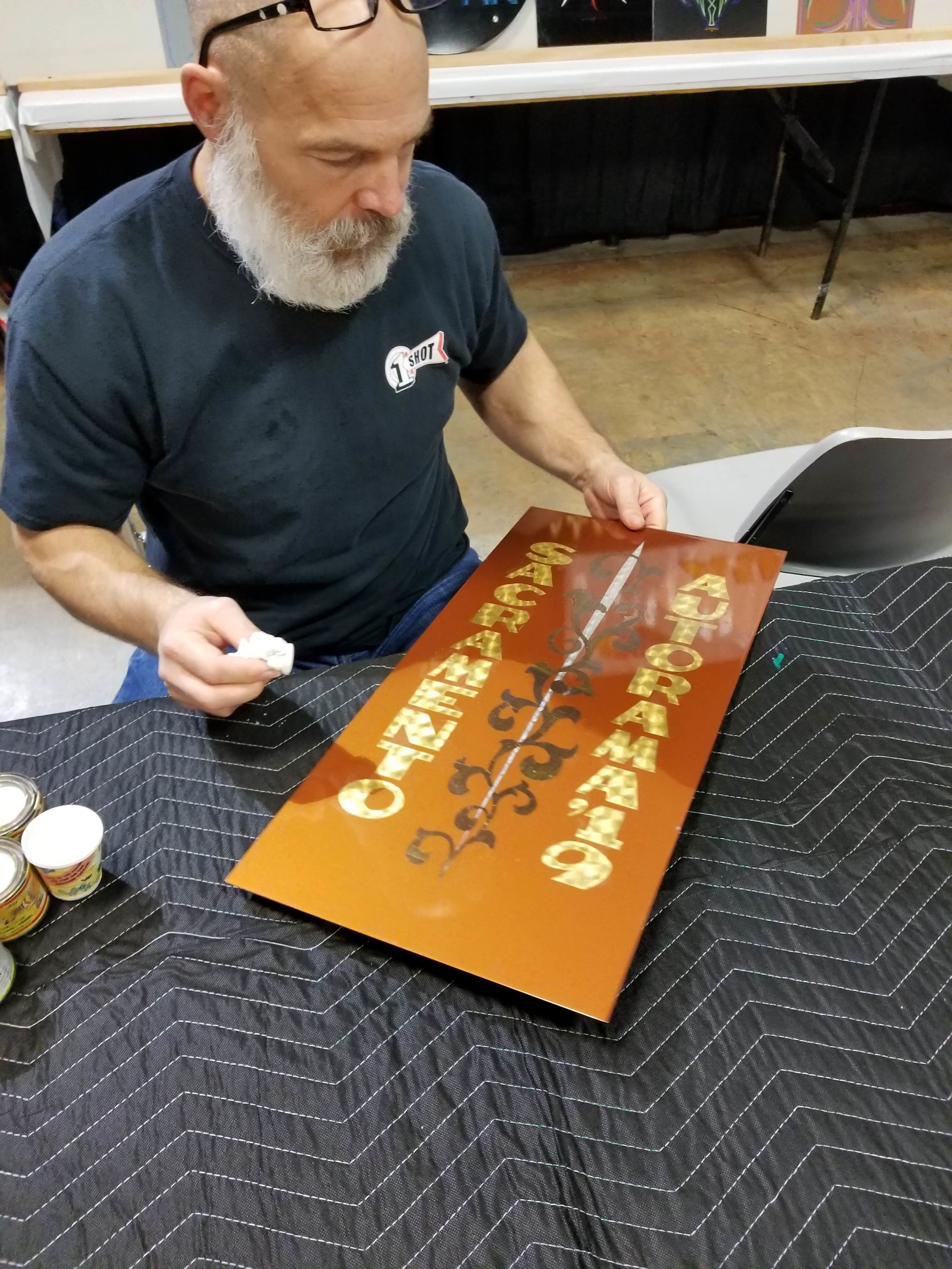 TLP favorite Ron Miller puts the finishing touches on his show themed artistry.
