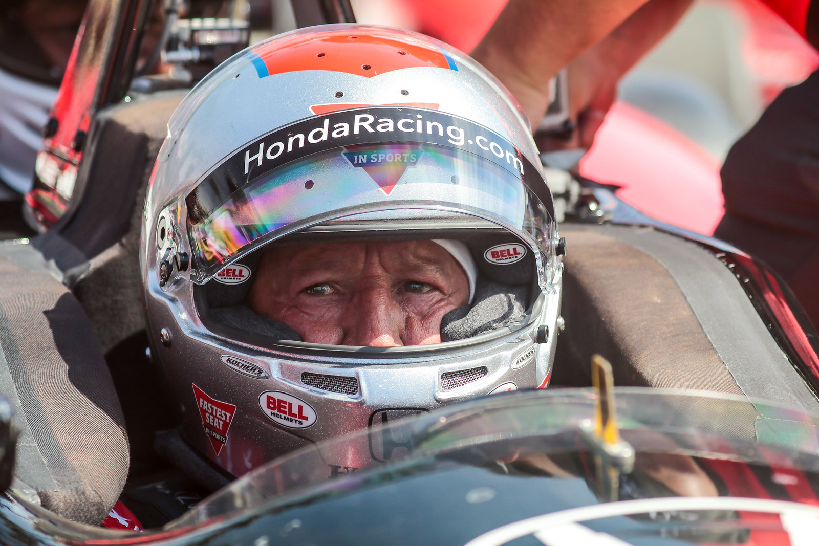 Legend Mario Andretti in the two seater IndyCar.