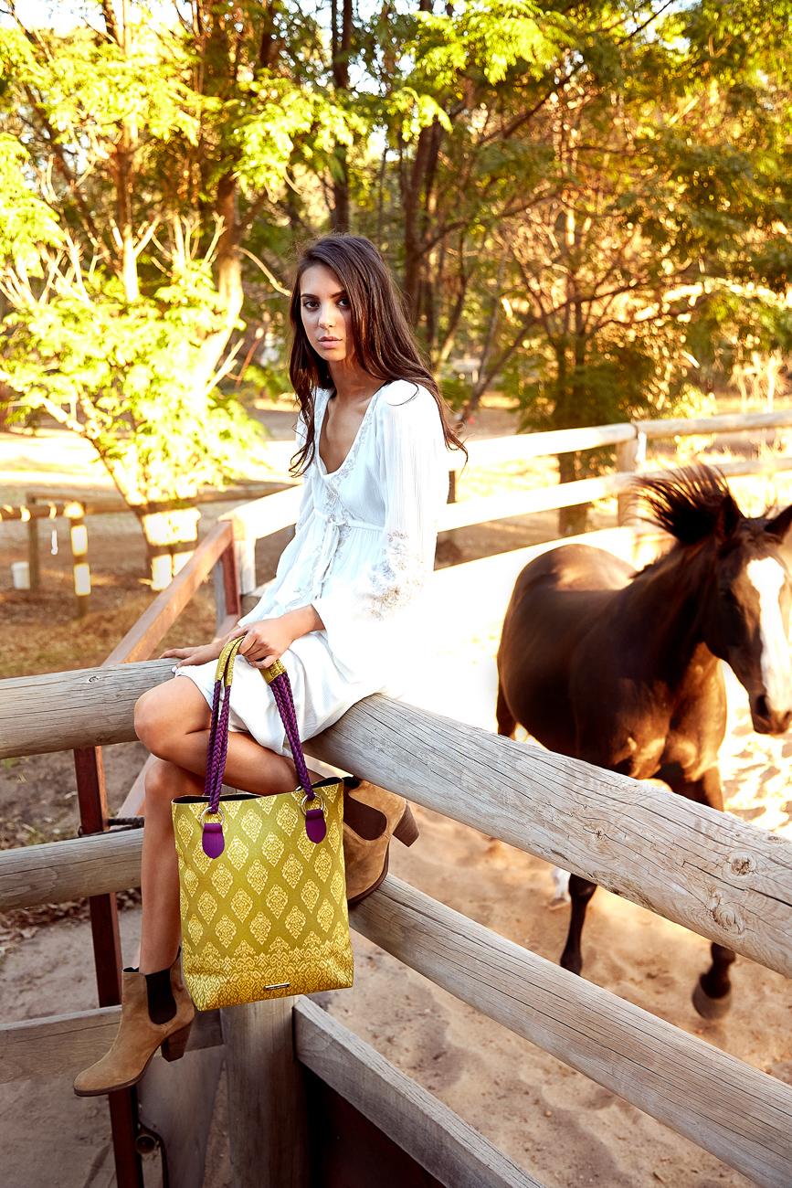 Yellow handbag with silk detailing and pink silk scarf