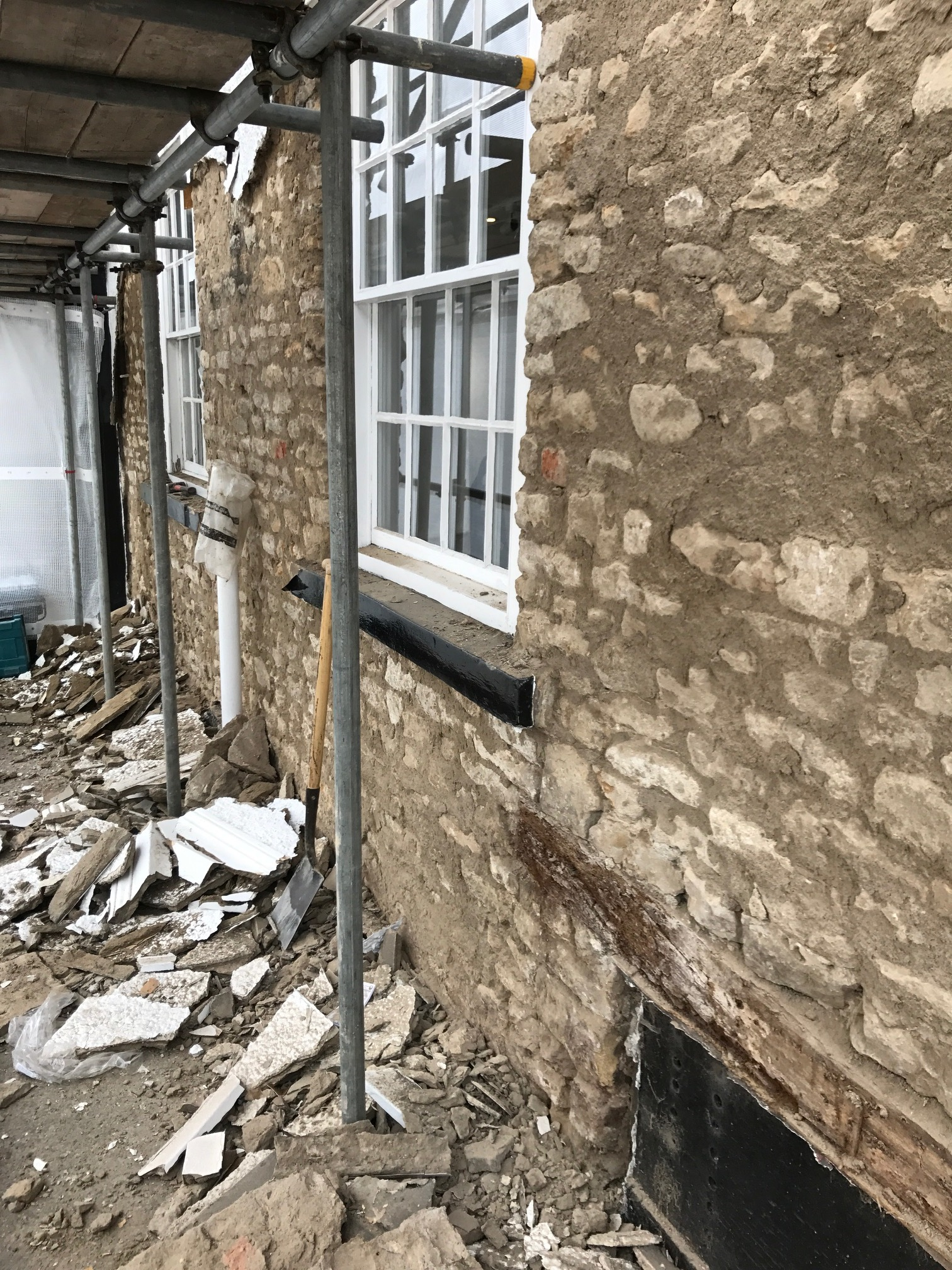 Back to Stone - The render is coming off to reveal some stunning limestone and sandstone for the first time in over a hundred years. This creates a dilemma, do we consider apply for Listed Building Consent to keep the stone on show?