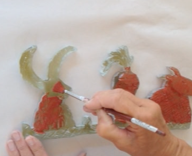 Then glass paint is added to the figures if necessary...