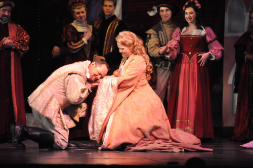 Rick Hilsabeck as Fred Graham/Petruchio and Sarah Pfisterer as Lilli Vanessi/Katherine and ensemble members. (Courtesy Reagle Music Theatre/Herb Philpott)