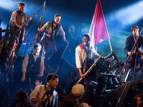 Kyle Scatliffe as Enjolras and the cast of Les Miserables / Michael Le Poer Trench