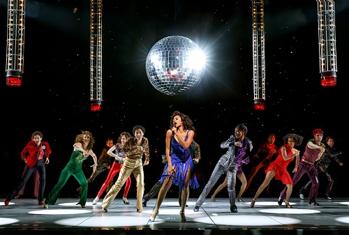 """Photo: Ariana DeBose as """"Disco Donna"""" and Company in """"Summer: The Donna Summer Musical."""" Credit: Joan Marcus."""