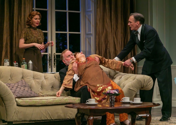 From left, Kate MacCluggage as Ruth, Ames Adamson as Mr. Bradman, Tina Stafford as Madame Arcati and Brent Harris as Charles in 'Blithe Spirit' at the Shakespeare Theatre of New Jersey in Madison.Photo by Jerry Dalia