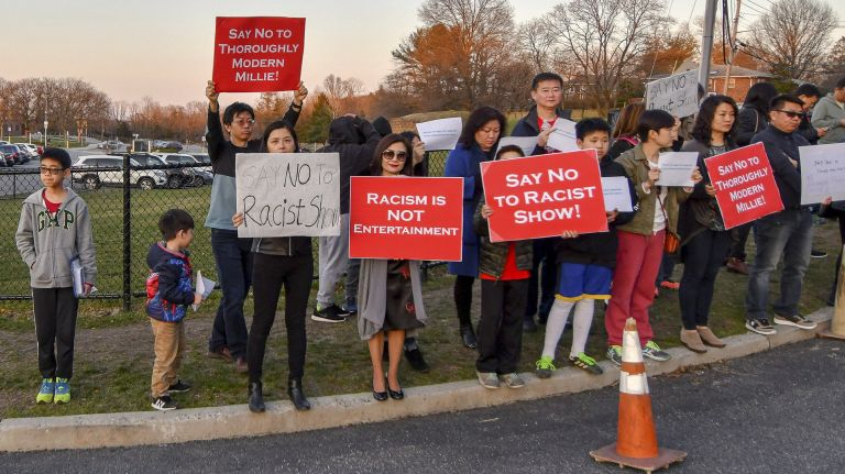 "Protesters demonstrate against the musical ""Thoroughly Modern Millie"" outside Huntington High School. Photo Credit: Howard Simmons"