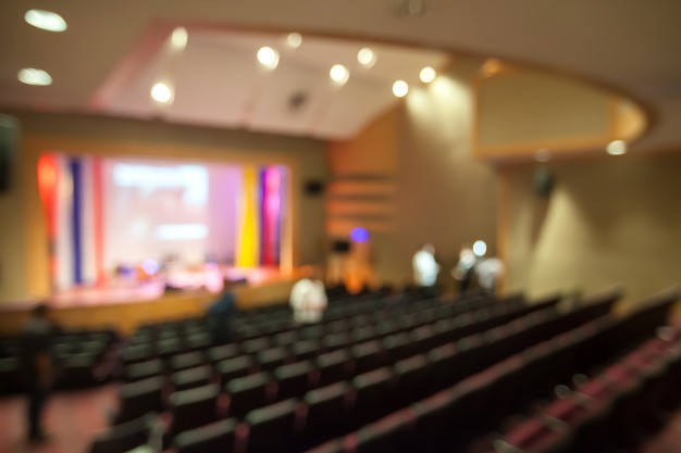blurry-background-theater-with-watching-stage-from-seat_2313-173.jpg