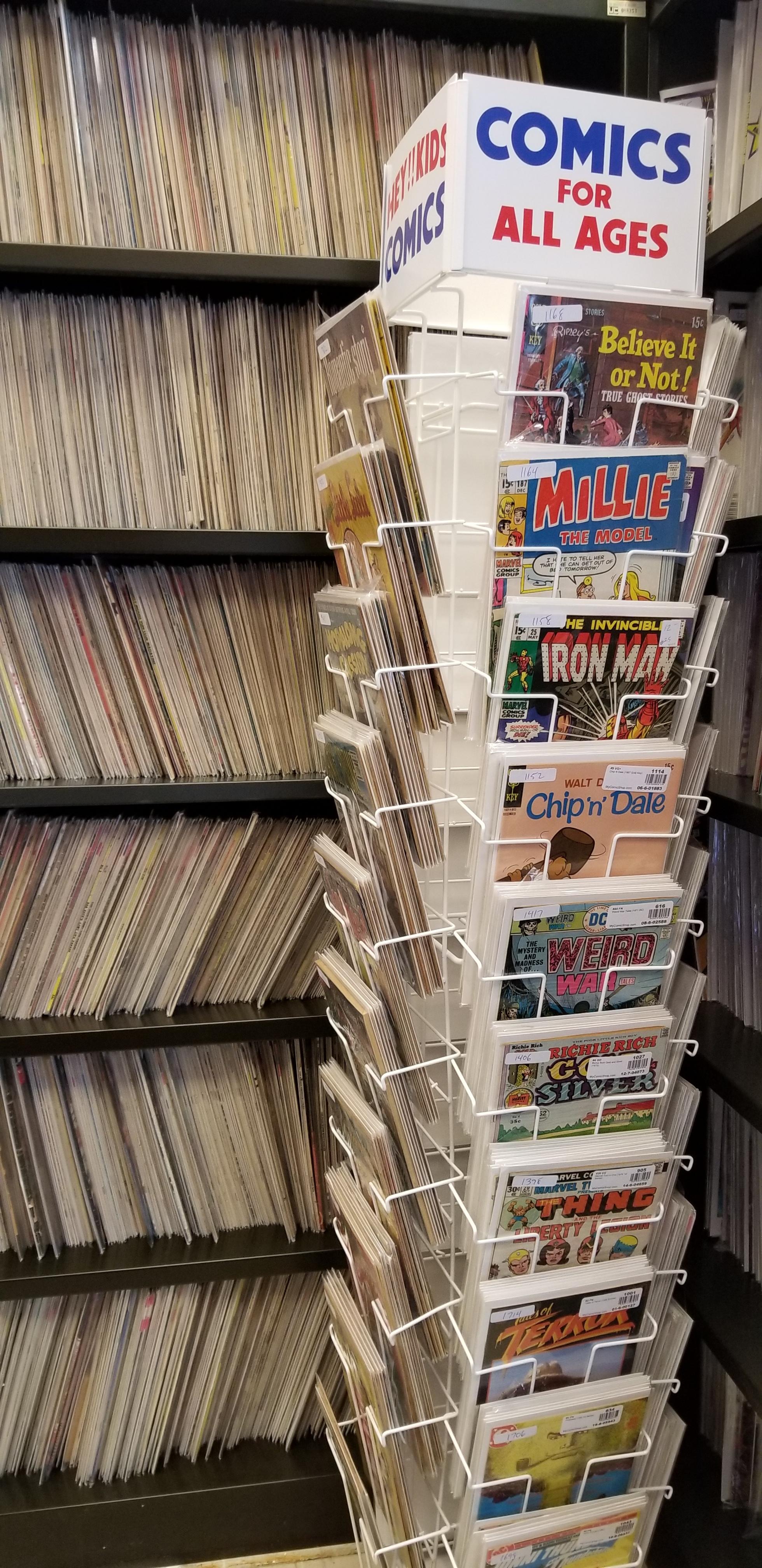 Ugly industrial shelving, wonderful spinner rack, so many comic books.