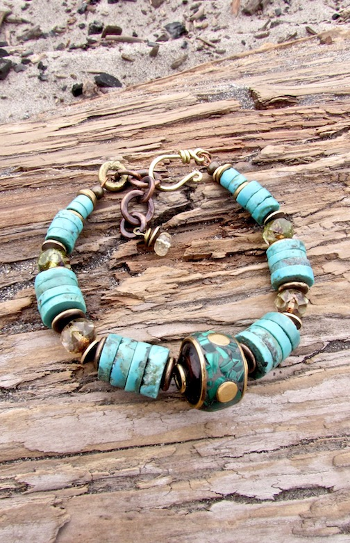 Turquoise and brass inlay Nepalese focal bead. Beach chic boho statement bracelet in turquoise with Czech glass.