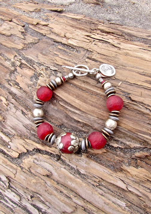Hill tribe silver OM meditation bracelet, with recycled African glass and Nepalese focal bead.