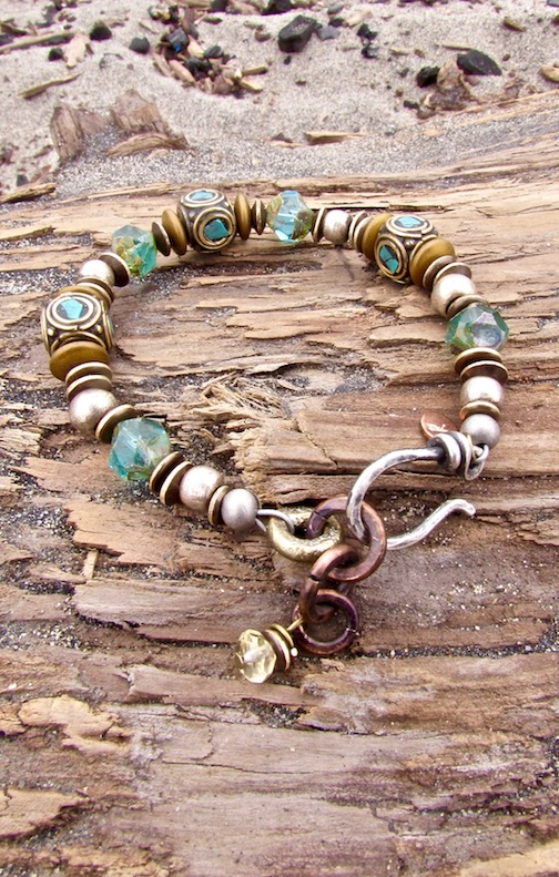 Turquoise and brass inlay Nepalese beads with aqua Czech glass. Sterling silver clasp, handmade by Rio Jewelry Stuido and copper chain by Patricia Healy.