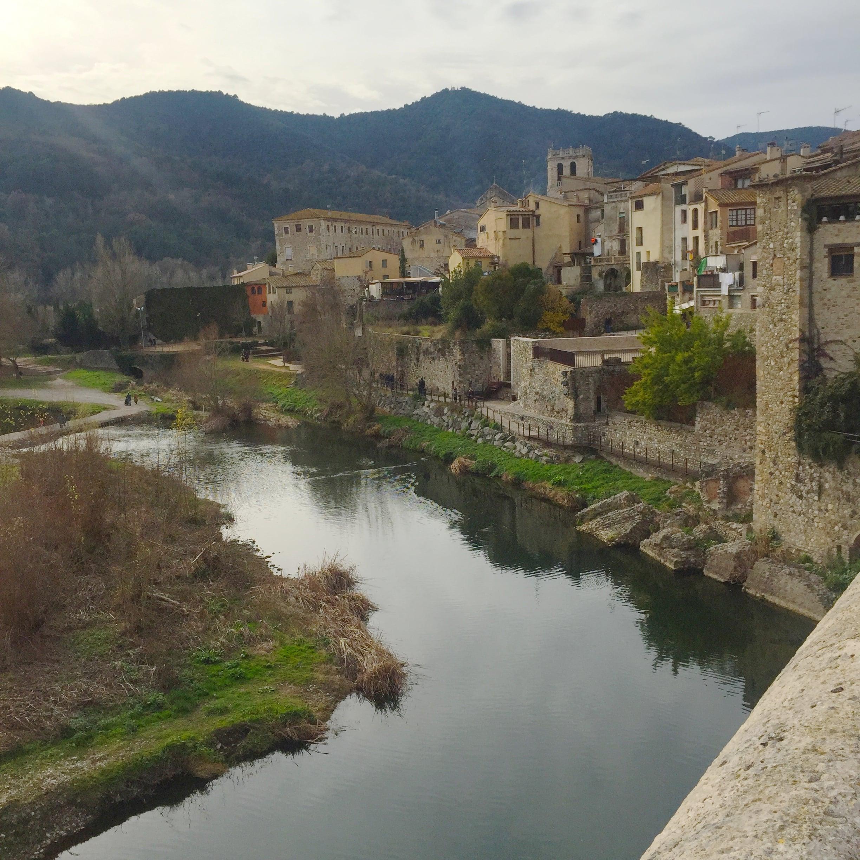 Besalú. On the Romanesque bridge verlooking the Fluvià river.