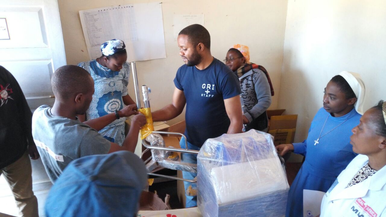 The Kipese hospital in the Democratic Republic of Congo receiving a microscope and lab supplies in July 2018. This hospital was looted and staff were killed earlier this year. These supplies will help rehabilitate the hospital, encourage the staff, and keep it serving this community.