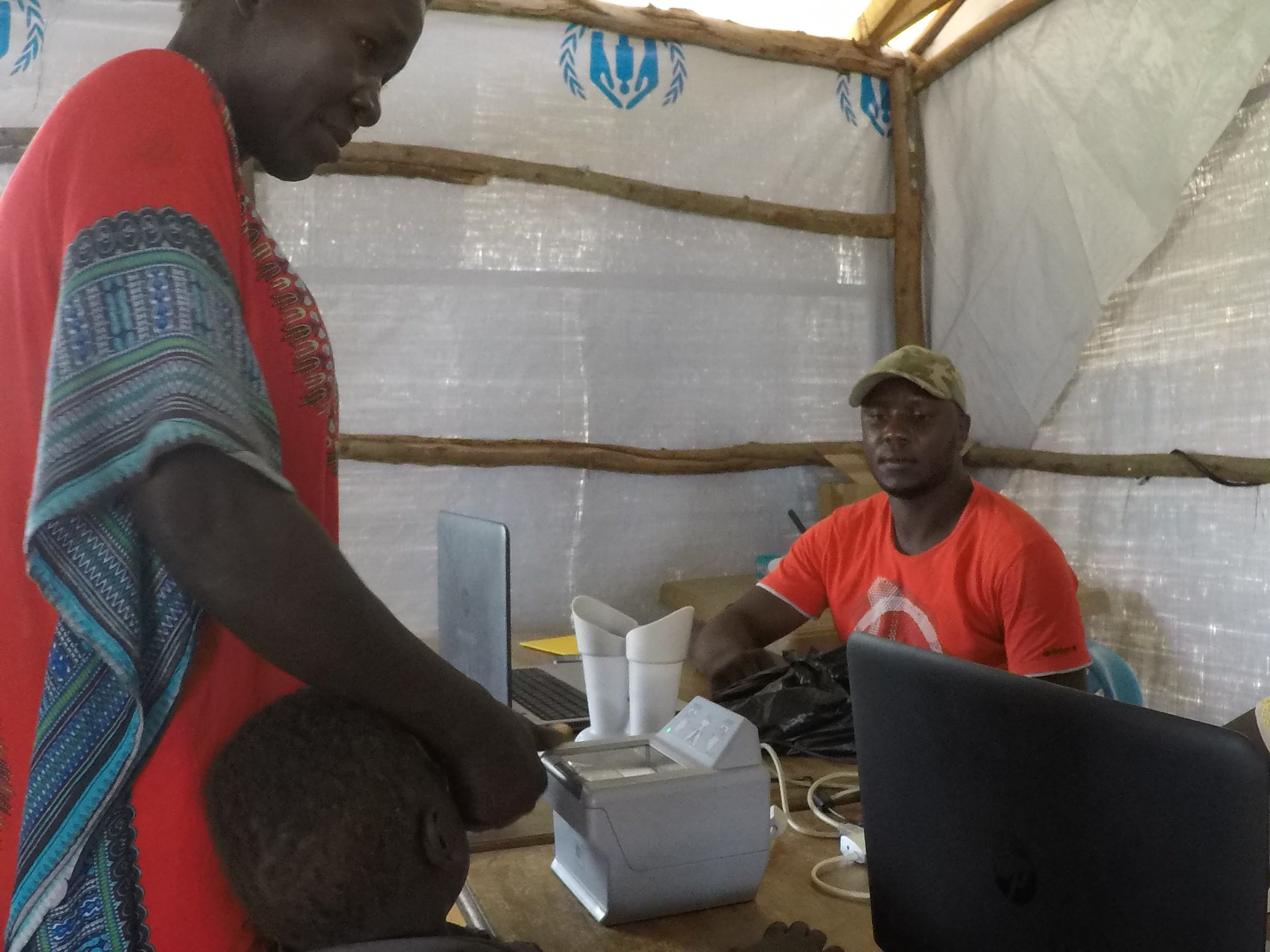 Biometric screening at the collection point to see if someone has already been registered as a refugee.