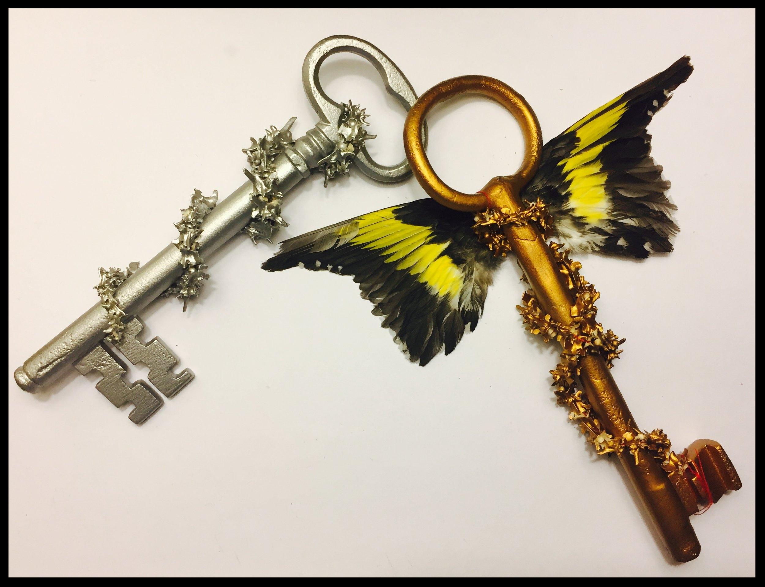 Keys tied with mother's red hair, Goldfinch wings, rattlesnake vertebrae