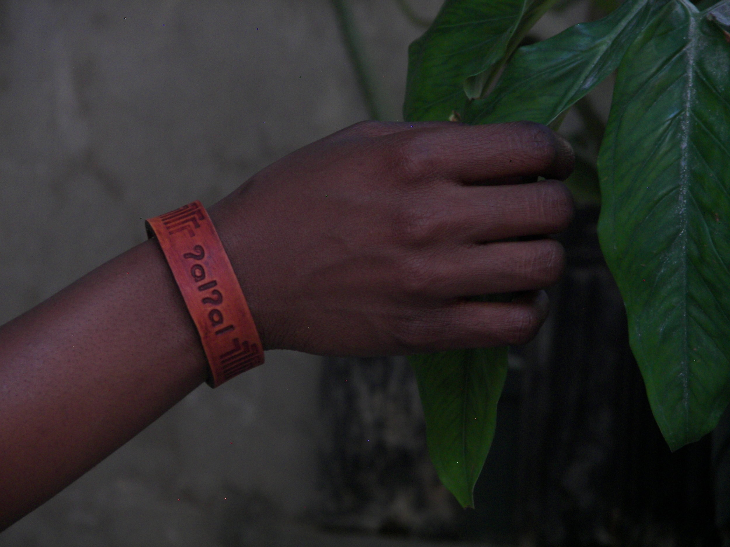 """Ismarie wearing her """"home"""" bracelet from Native Works. Native Works is a social enterprise in Seattle that creates arts based employment for members who are experiencing homelessness."""