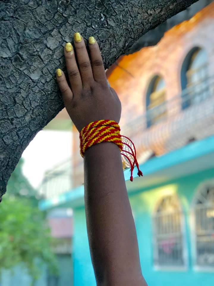 Ismaries' business Art Lakay makes colorful bracelets and crocheted clothing inspired by Haiti. All of the pieces are made by her and her friends who are living in Haiti.