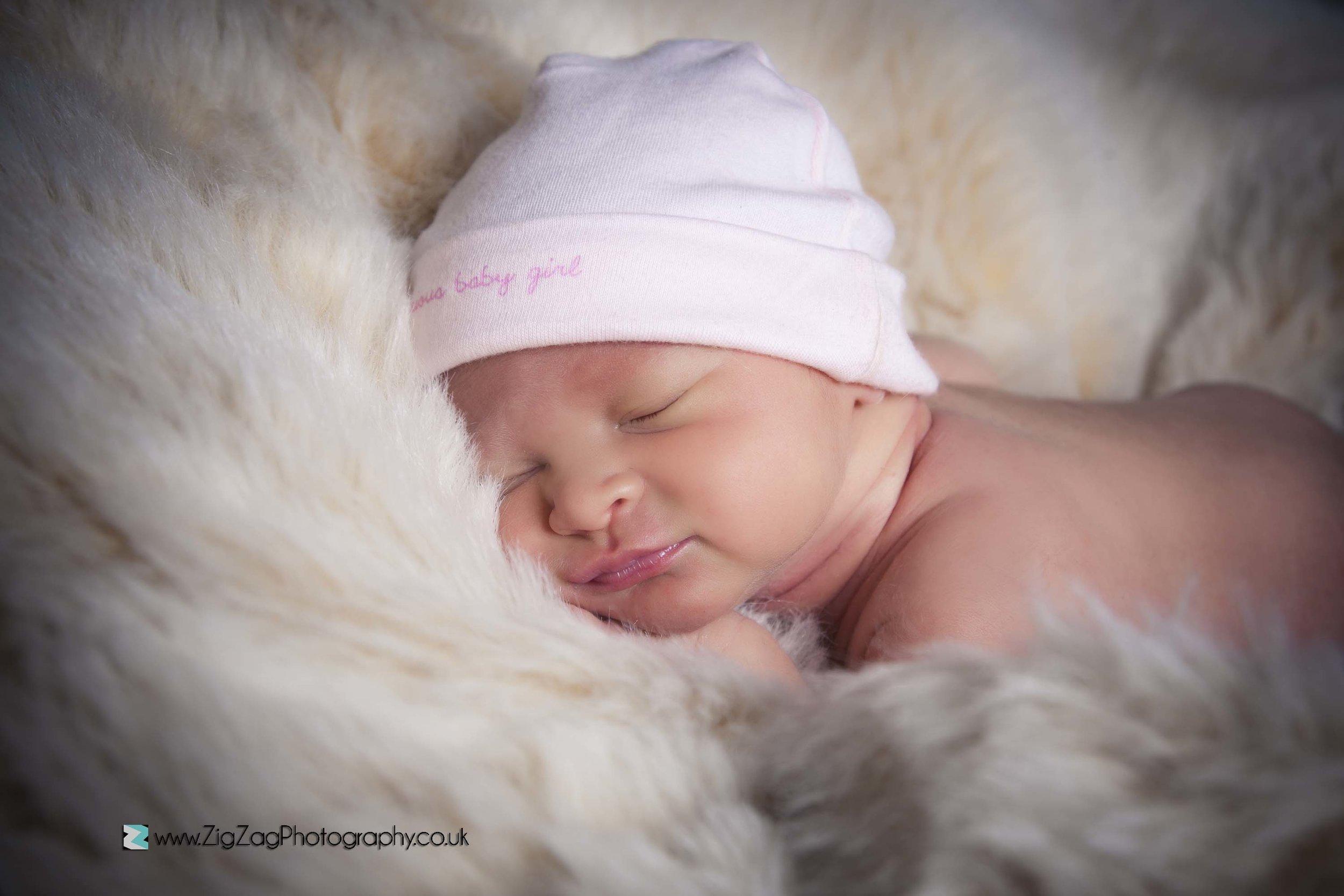newborn-photography-photoshoot-leicester-studio-baby-fur-sleeping.jpg