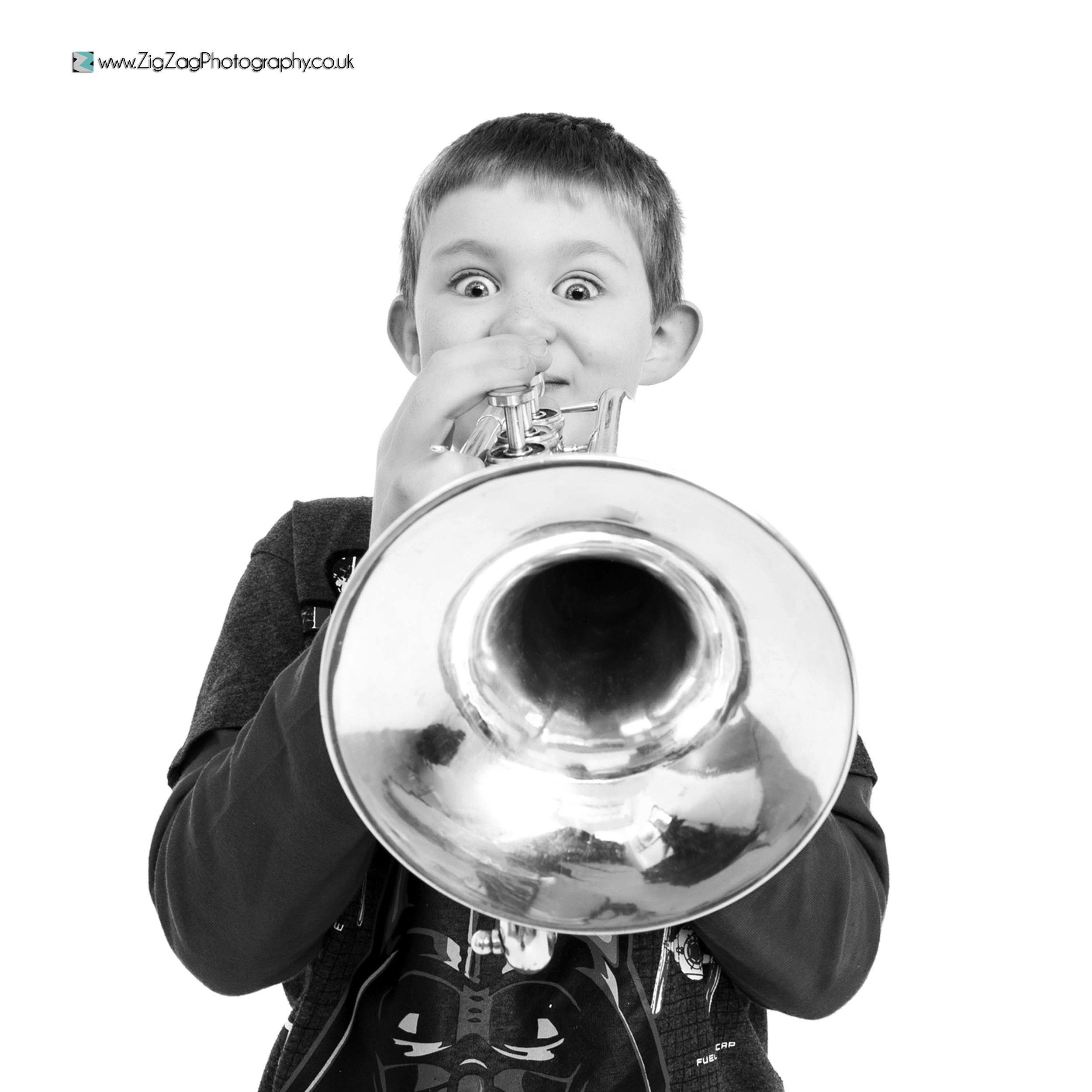 photography-studio-leicester-photoshoot-intrument-brass-trumpet-black-white-props-ideas-hobbies-boy-children.jpg