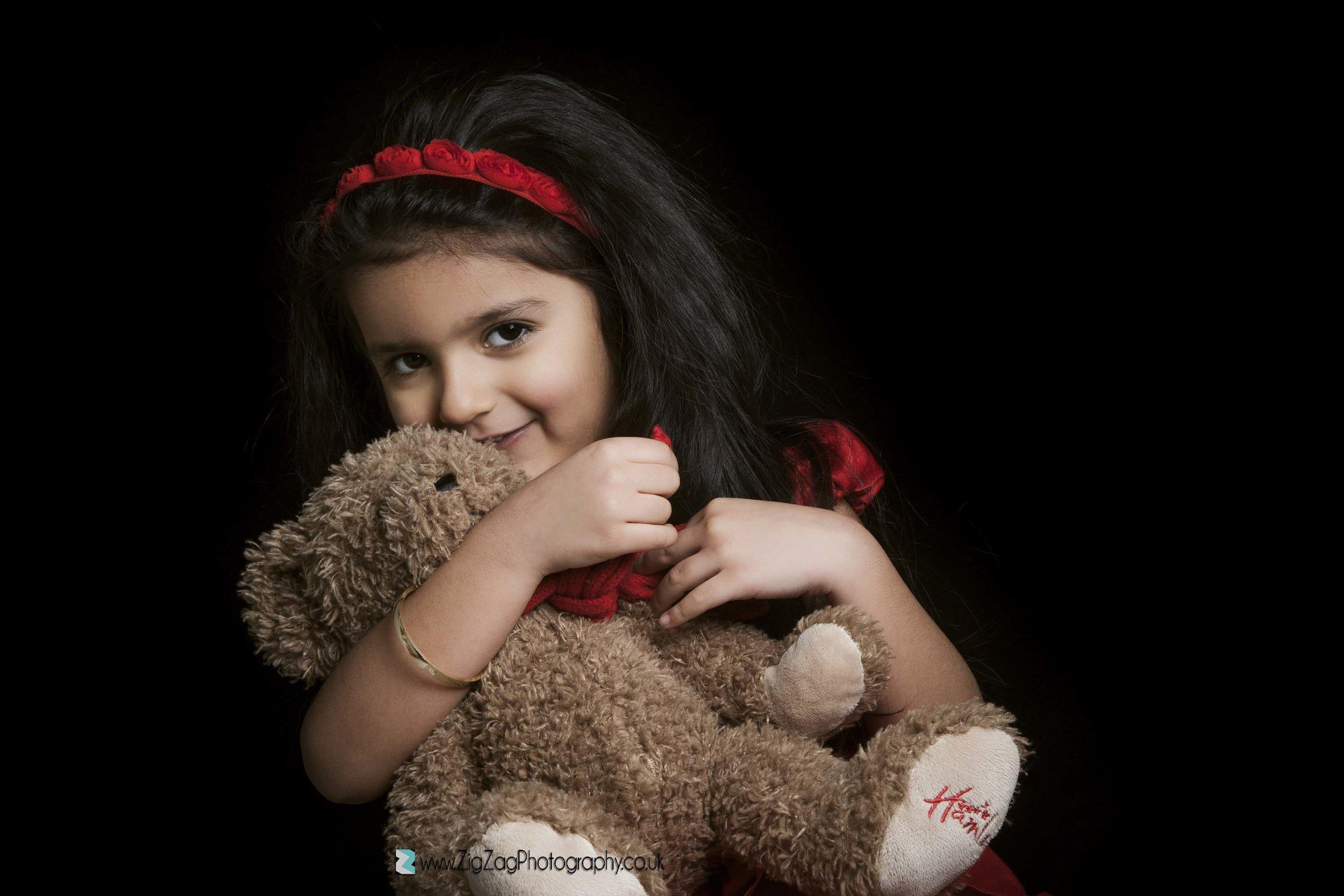photograpjhy-studio-leicester-photoshoot-kids-girl-red-headband-teddy-bear-ideas-props.jpg
