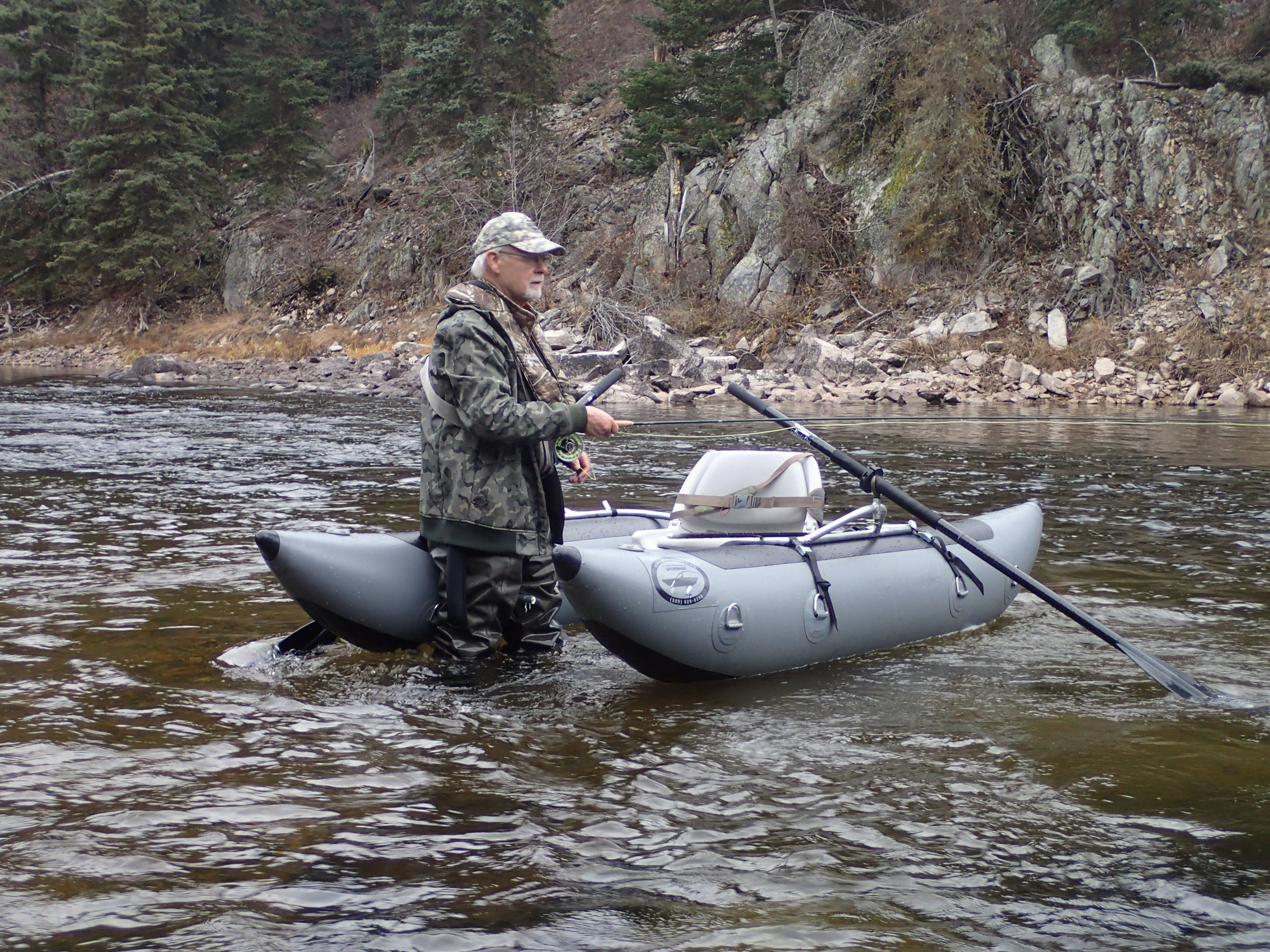 Ken fishing for rainbow trout in Canada.