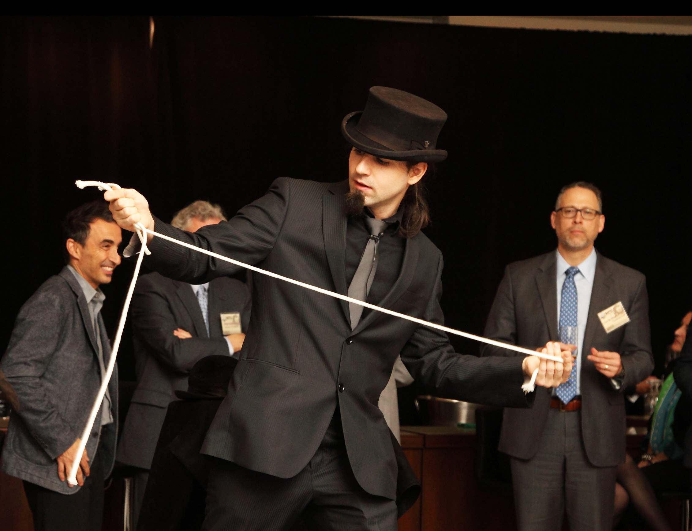 Spencer Scurr Performs His Rope Magic Routine at A Stage Show for a Company Event