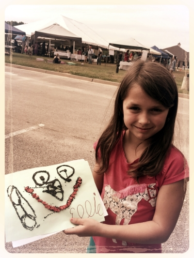 """Ellie grace with her """"seed art"""""""