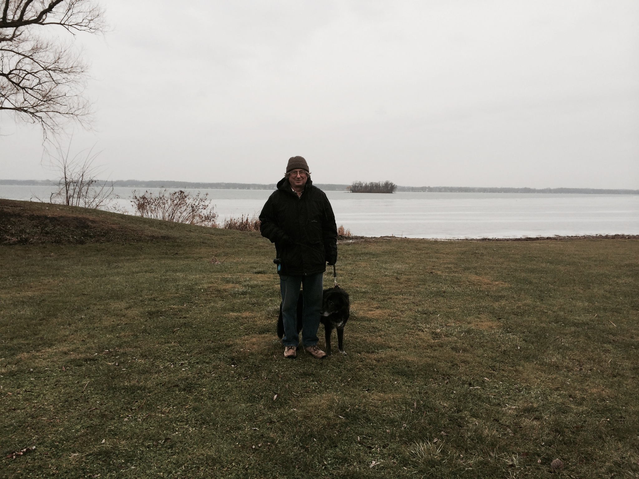 Ed and Alice at the Cayuga Lake Shore with Frontenac Island in the background