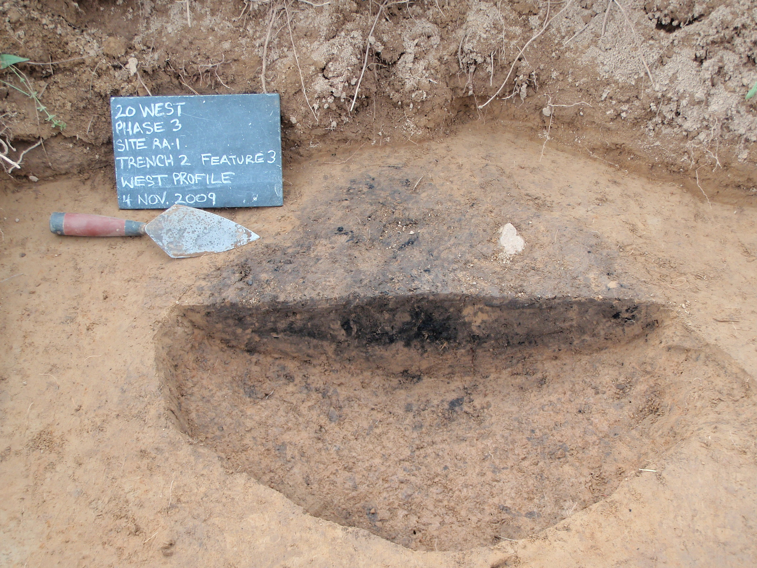 Cross-section of hearth dated to 4040 +/- 60 B.P. (2930 BC) at the Wild Carrot site