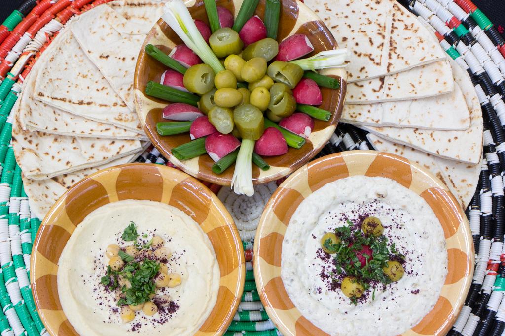 Bottom:  Hummus  (left) and  Mutabal  - similar to Baba Ghanouge, roasted eggplant, tahini, labaneh, garlic, lemon juice