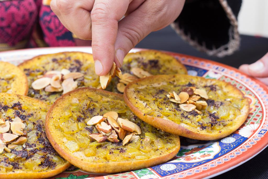 Musakhan  - baked pita, caramelized onions, roasted almonds and sumac