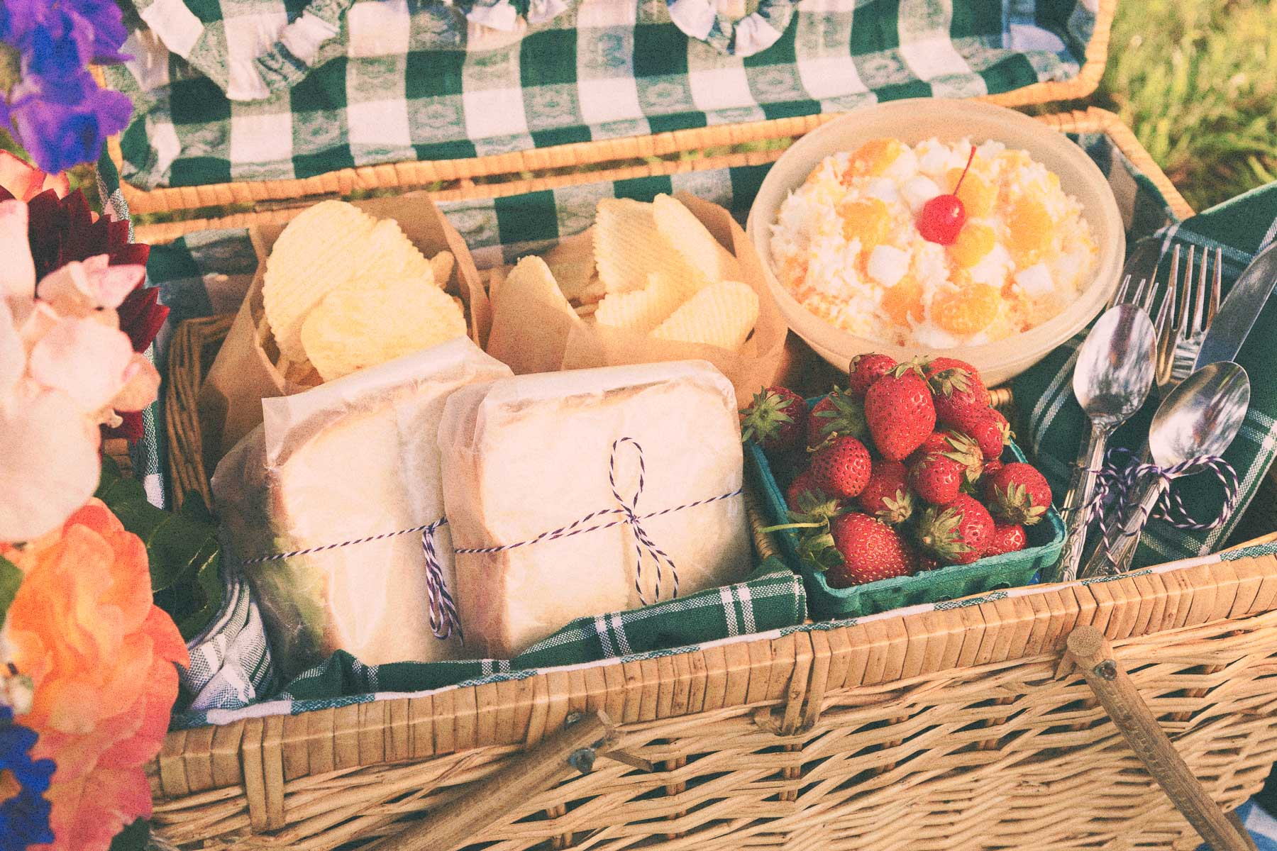 Tomato and Cheese Sandwiches, Ruffles Chips, Ambrosia Salad, and Strawberries to go