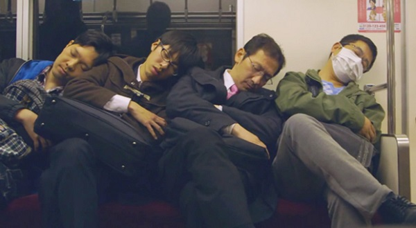 Japanese men sleeping on subway