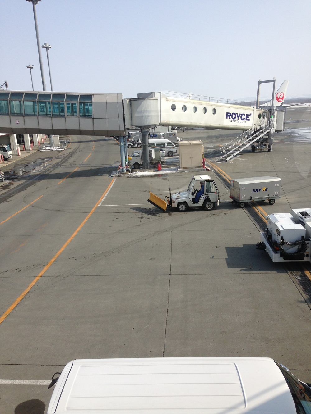 snowplow on airport baggage cart in Japan