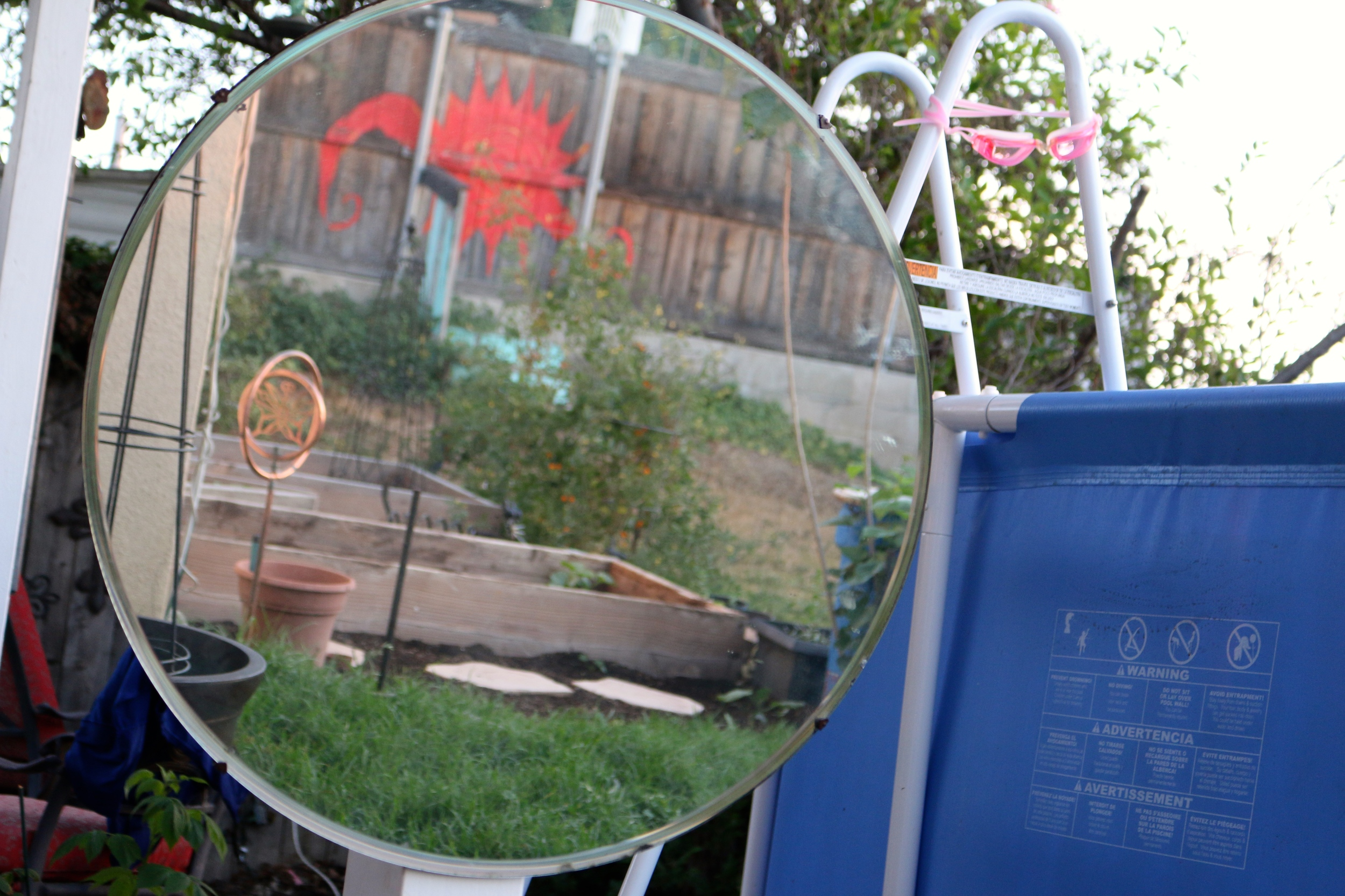 I bought a new/old mirror to hang in the back yard. It was at a yard sale on my very own block.