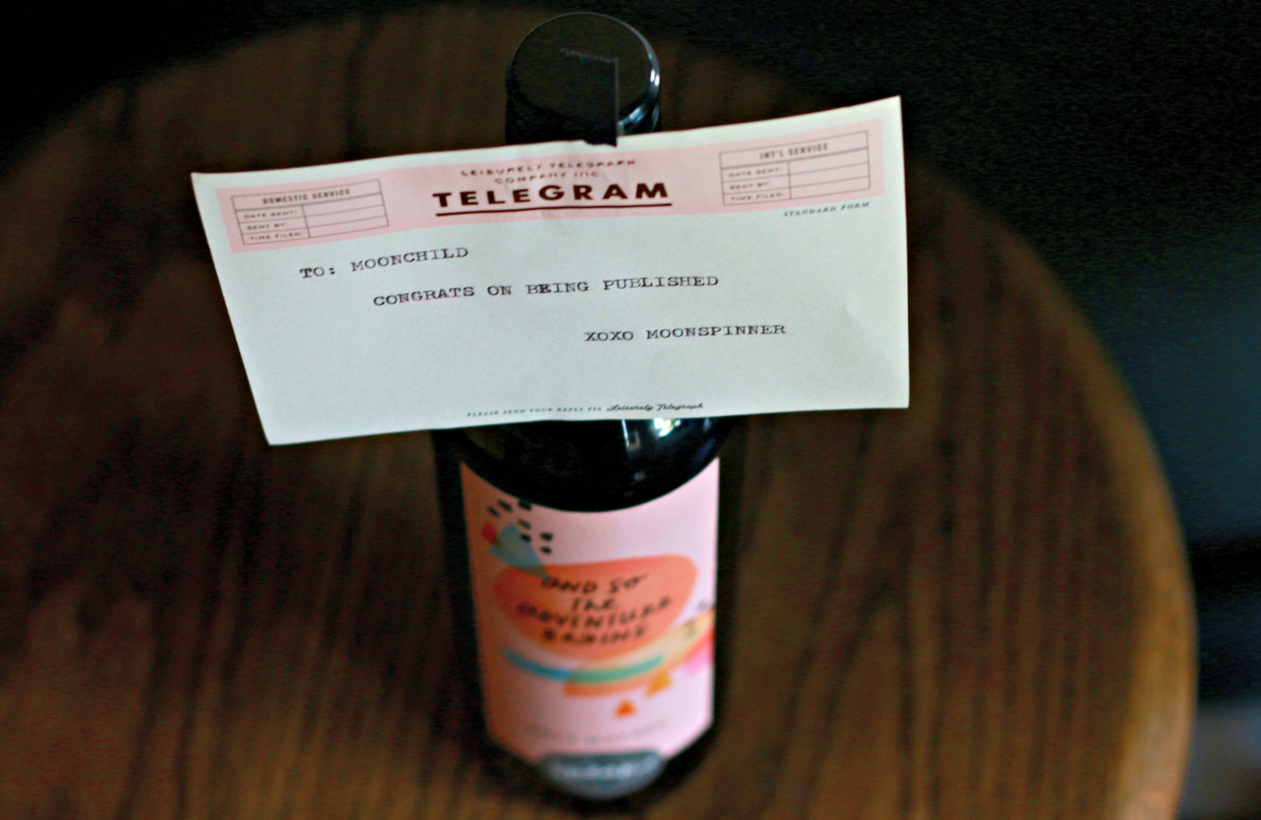 """A typed telegram totally awesome, a perfect darling """"and so the adventure begins"""" bottle of wine out of this world amazing...the support of my fellow moon peep....PRICELESS!"""