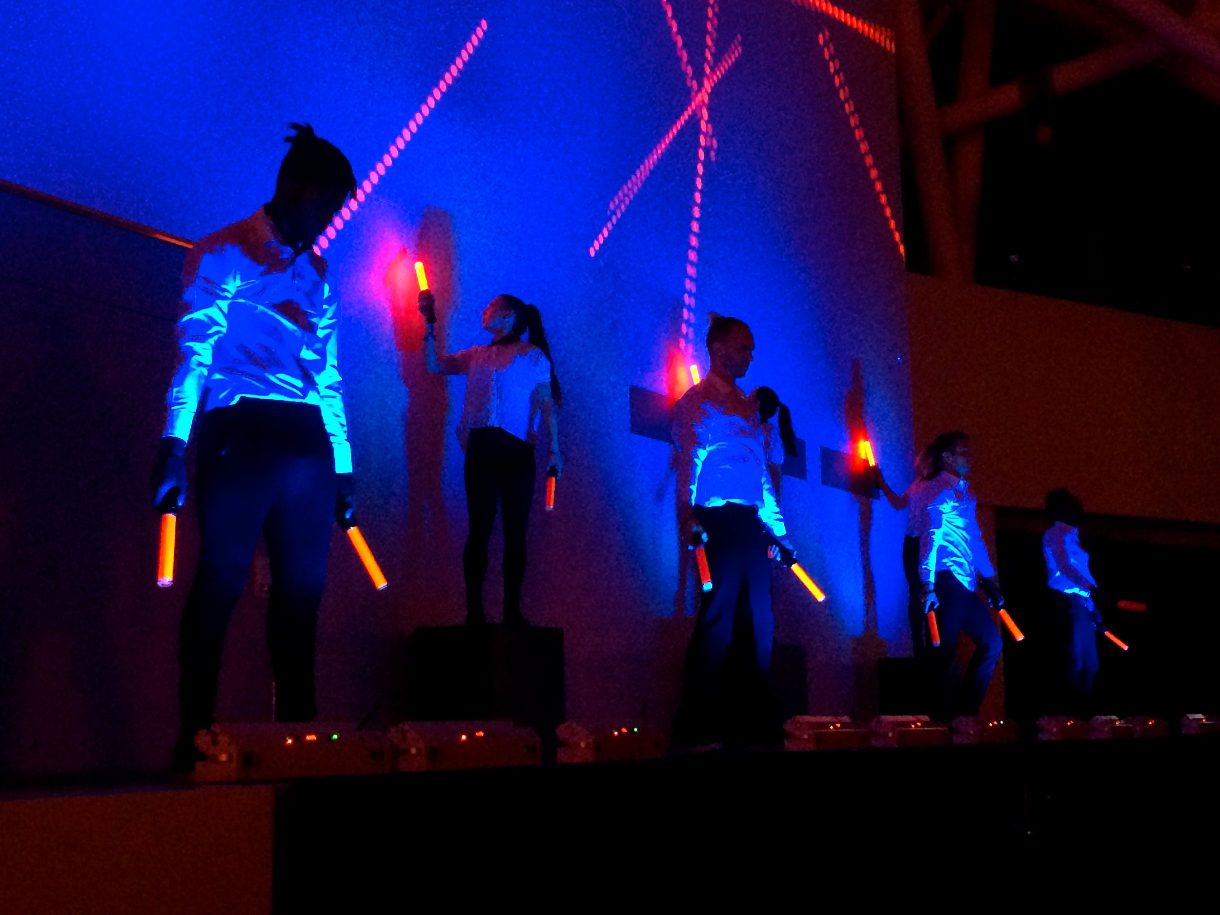 Dancers interacting with music, lights, & projections in an airport controller inspired Opening ...