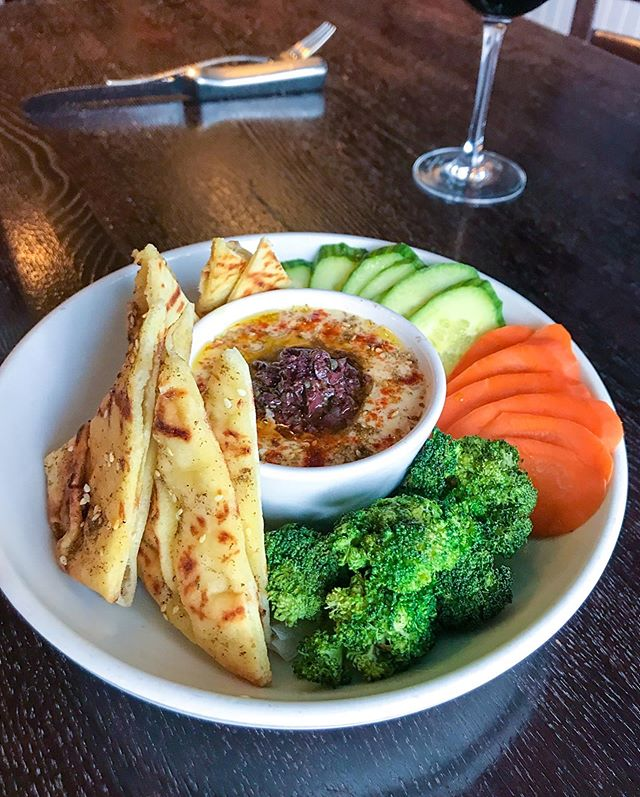 Our Hummus Plate w/ Grilled Za'tar Pita Bread, Olive Tapenade, Sliced Carrots, Cucumber and Broccoli! Treat yourself!! #YUM ☀️🥦🥕🥒