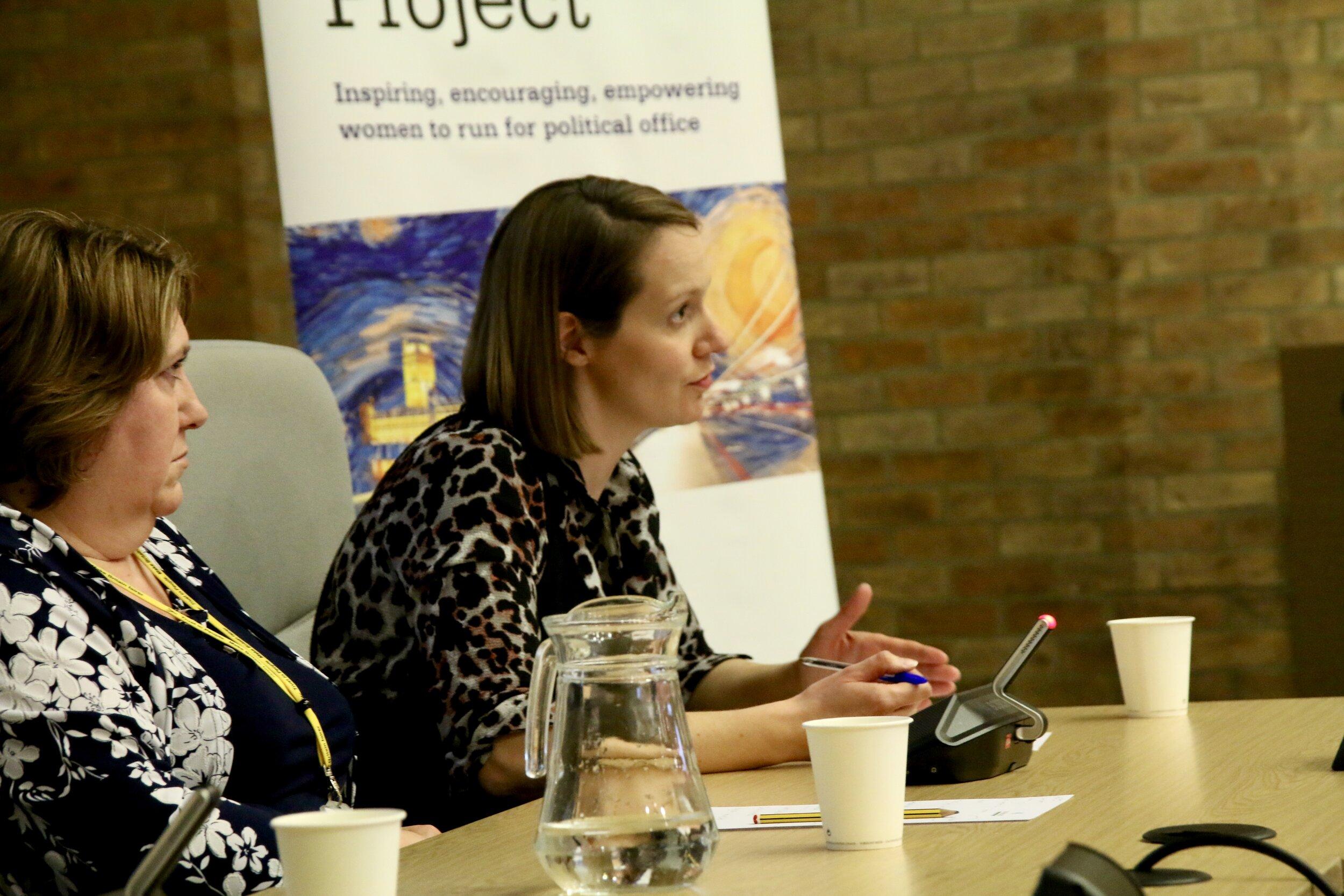 A Milton Keynes city councillor speaks on a panel at a Parliament Project workshop.
