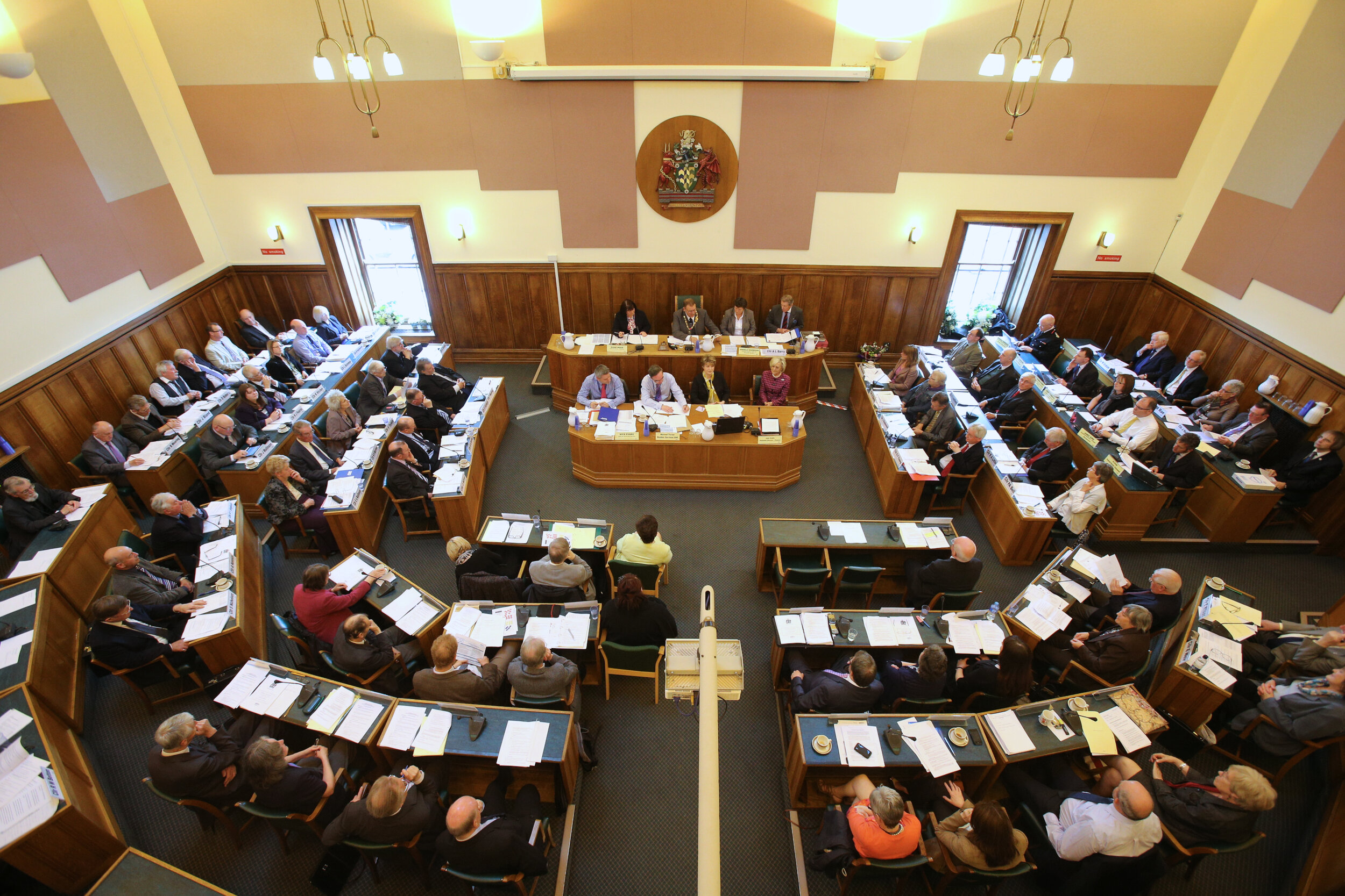 County councillors are seated for a session in an England county council,
